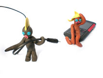 Plasticine people figures with phones and usb Stock Photos