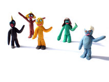 Plasticine people figures saying hi Stock Photo