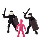 Plasticine police beating children Stock Photos