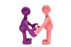 Plasticine puppets standing opposite each other Stock Image