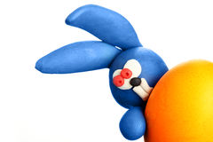 Plasticine rabbit with easter egg Royalty Free Stock Photo