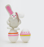 Rabbit with easter eggs Stock Photos