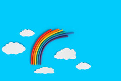 Plasticine Rainbow. Near white paper clouds on blue background Stock Photo