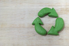 Plasticine recycle symbol. In the left there is free space for tittle and text Royalty Free Stock Photo