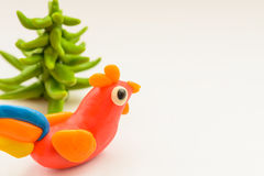 Plasticine rooster cock. Stock Image