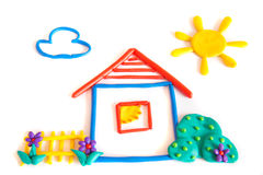 Plasticine small house. Small house, clay (plasticine) modeling isolated on white background royalty free illustration