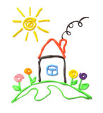 Plasticine small house. Small house and the sun. It is made of plasticine Stock Images