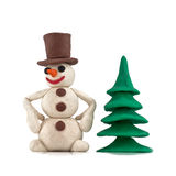 Plasticine snowman. Standing near the Christmas tree isolated on white background Royalty Free Stock Photos