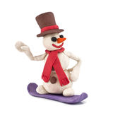 Plasticine snowman riding snowboarders. On white background Stock Photo