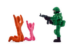 Plasticine soldiers seized hostages isolated on white background Royalty Free Stock Images
