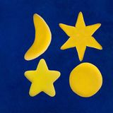 Plasticine star and moon on blue sky