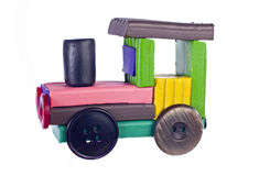 Plasticine steam locomotive. With wheels made of buttons Royalty Free Stock Photography