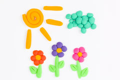 Plasticine sun, sky, cloud and flower. Stock Photo
