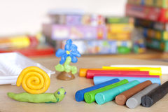Plasticine on table with snail abstract background Royalty Free Stock Photo