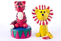Plasticine tiger and lion. Plasticine lion and tiger from circus playing Royalty Free Stock Images