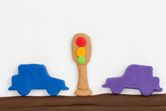 Plasticine traffic light and car. Royalty Free Stock Images