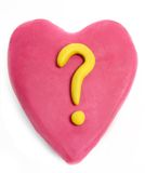 Plasticine valentine. Heart made with plasticine with question mark isolated on white royalty free stock photography