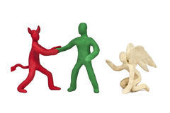 Plasticine victory of evil over good is isolated on a white background Stock Photo