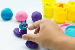 Plasticine on white background Stock Photos