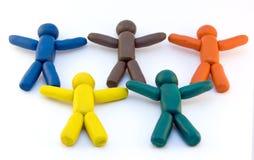 Plasticinemänner und olympische Ringe Lizenzfreie Stockbilder