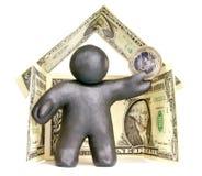 Plasticinemens in het huis van bankbiljetten Stock Fotografie