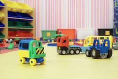 Plastics car toys in room for children Stock Photo