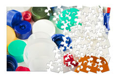 Plastics recycling concept image in jigsaw puzzle shape.  royalty free illustration