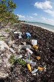 Plastics Washed onto Caribbean Beach Royalty Free Stock Image