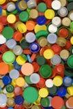 Plastik bedeckt Hintergrund mit einer Kappe Stockbild