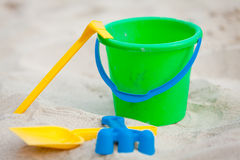 Plastik colorful toys in sand on beach Stock Photography