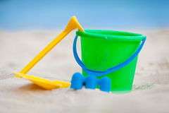 Plastik colorful toys in sand on beach Stock Photos