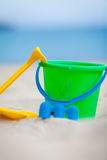 Plastik colorful toys in sand on beach Royalty Free Stock Photos