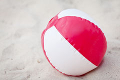 Plastik colorful toys in sand on beach Stock Image