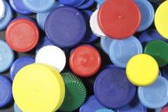 Plastik farbige Kappen Stockbild