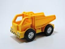 Plastik-Toy Trucks auf weißem Hintergrund Lizenzfreie Stockbilder