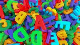 Plastikalphabetbuchstaben auf weißem Hintergrund stockfotos