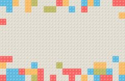 Plastikbaublockhintergrund Kinderspielzeug-Gebäude blo Lizenzfreie Stockfotografie