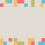 Plastikbaublockhintergrund Kinderspielzeug-Gebäude blo Stockbilder