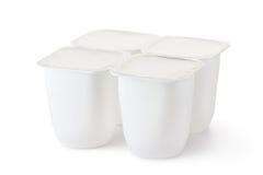 Plastikbehälter vier für Milchprodukte Stockbild