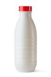 Plastikflasche mit roter Kappe für Milchspeisen Stockbilder