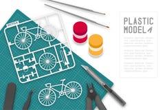 Plastikmodell mit Tool-Kit auf Schneidematte, Fahrradkonzeptdesignillustration Stockbild