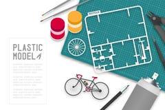 Plastikmodell mit Tool-Kit auf Schneidematte, Fahrradkonzeptdesignillustration Lizenzfreies Stockfoto
