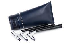 Plastikowa błękitna tubka ogolenie żyletki i gel ostrza Zdjęcia Stock
