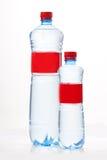 Plastikowa butelka z czerwoną etykietką Fotografia Royalty Free