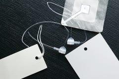Plastikowa etykietki skowa reprezentuje moda handlu detalicznego narzędzie zdjęcia stock