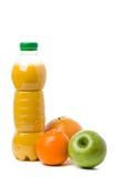 plastikowe butelki owoców soku Fotografia Stock