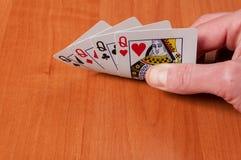Plastikowe grzebak karty na drewnianym tle Fotografia Stock