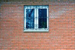 Plastikowy okno na czerwonym ściana z cegieł Obraz Royalty Free