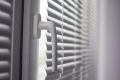 Plastikowy okno z storami zdjęcie stock