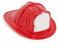 Plastikspielzeug-Feuer-Kämpfer-Hut Stockfoto